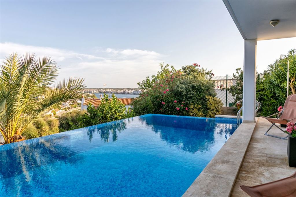 Wonderful villa with pool at Cala Llonga in Menorca with views over the port of Mahon