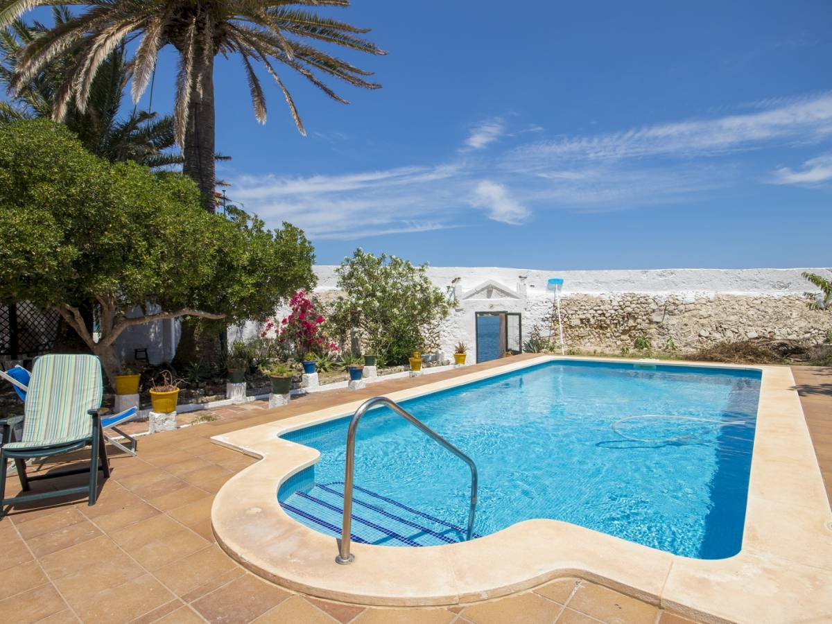 Unique front line villa in Es Castell with a magnificent view