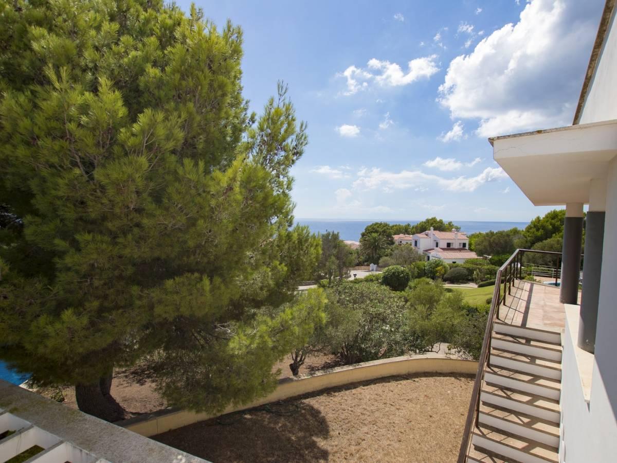 Modern villa with spectacular views over the beach of Santo Tomas in Menorca