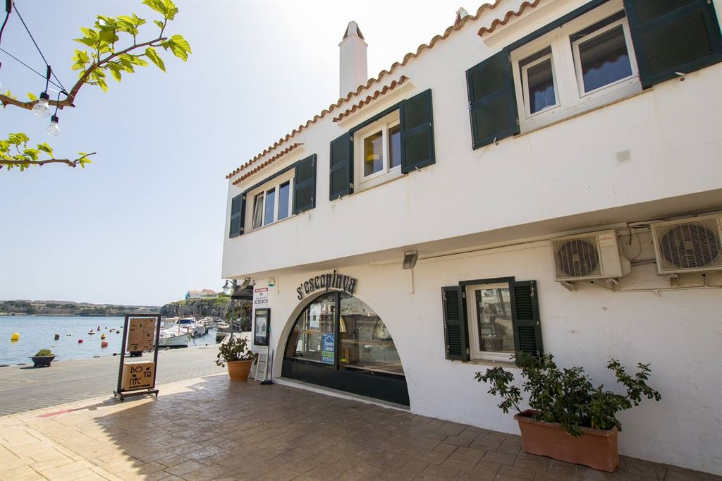 Residential and commercial building in the front of the sea in Cala Fonts Menorca